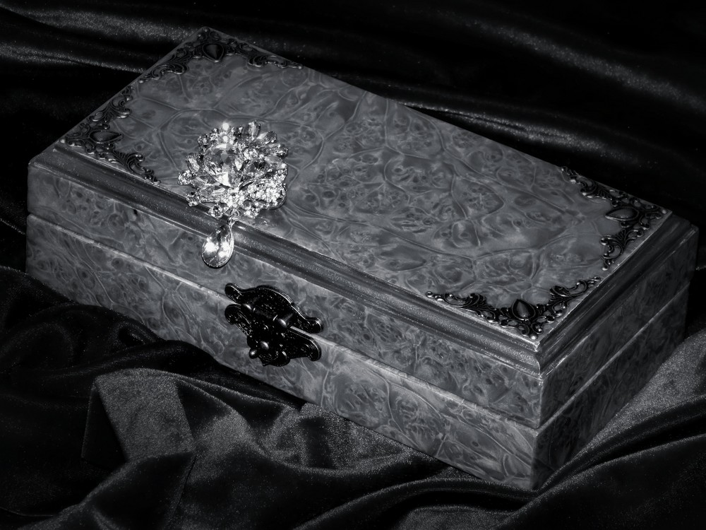 Box with brooch in black and white image